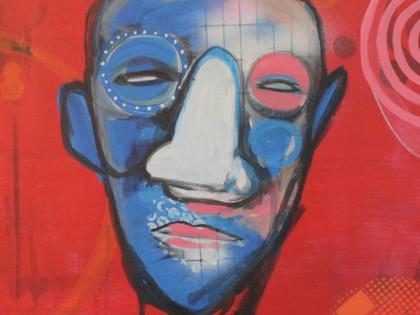 Rødt maleri med ansigt